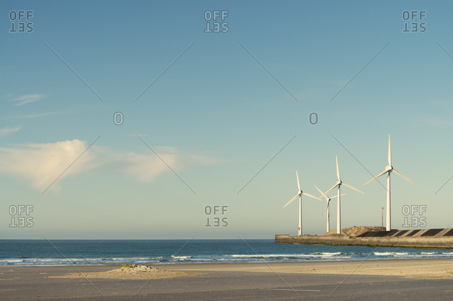 Wind turbines on the sea wall, Boulogne, France