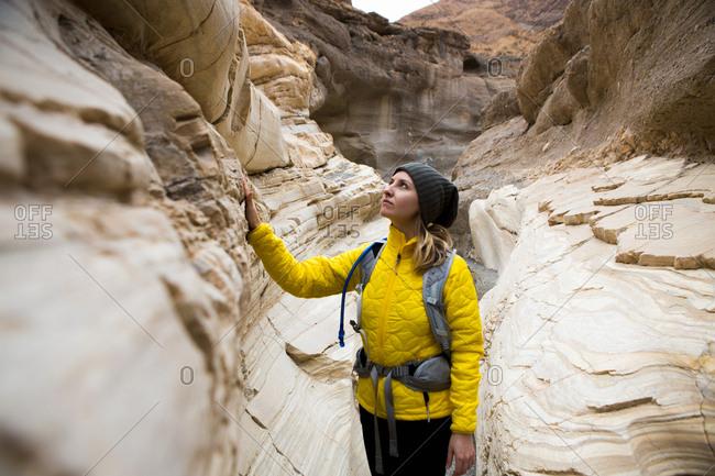 Trekker taking in sights, Death Valley National Park, California, US