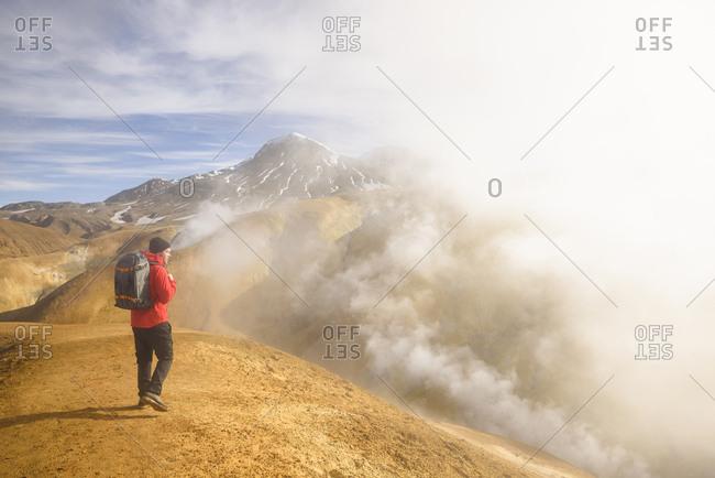 Hiker surrounded by geothermal smoke, Kerlingarfjoll, Iceland