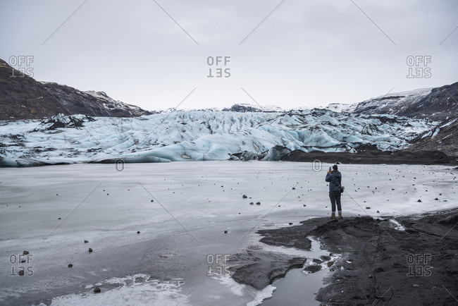 Man looking at view, Solheimajokull, Iceland