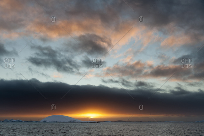 Sunset over icebergs in Lemaire channel, Antarctica