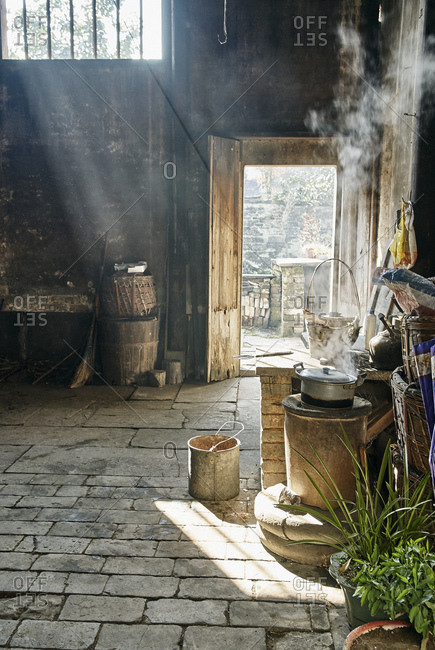 Stove and flagstones in interior space, Hongcun Village, Anhui Province, China