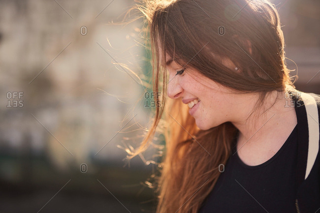 Portrait of young woman, outdoors, smiling, Bristol, UK