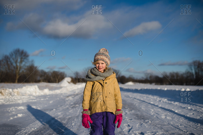 Girl in winter clothing on snow-covered path, Lakefield, Ontario, Canada