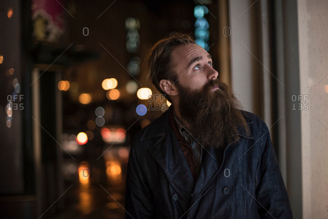 Mid adult man walking in city at night, Downtown, San Francisco, California, USA
