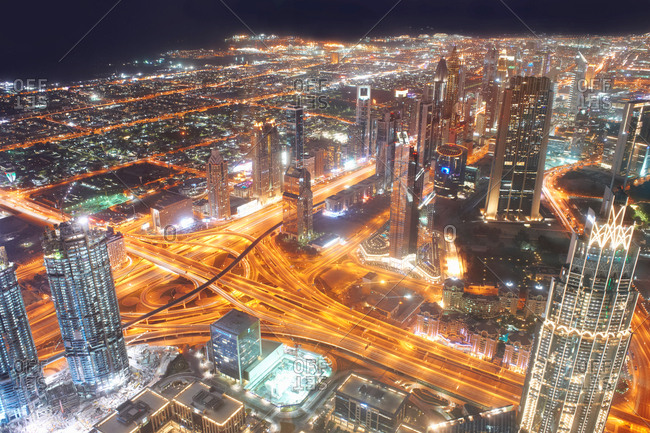 Cityscape at night showing light trails, elevated view, Dubai, UAE