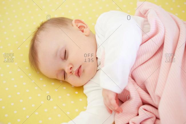 Sleeping baby girl in crib