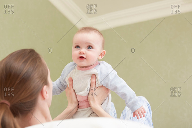Women holding up baby daughter
