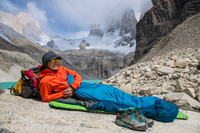Female hiker camping out at Torres del Paine National Park, Patagonia, Chile