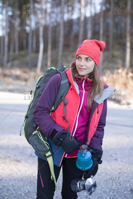 Female hiker holding camping stove in Bavarian Alps