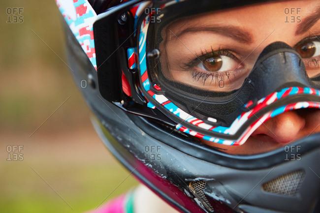 Close up portrait of female bike rider in crash helmet