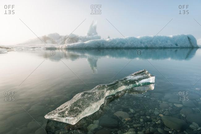 Misty view of ice bergs on glacial lagoon, Jokulsarlon, Iceland