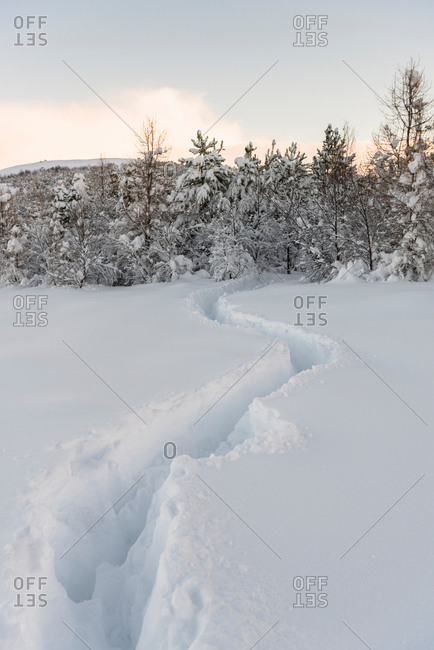 Trails through deep snow at Lake Reynisvatn, Iceland