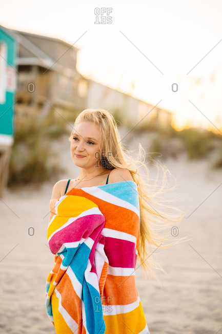 Young woman wrapped in beach towel at Carolina Beach, North Carolina, USA