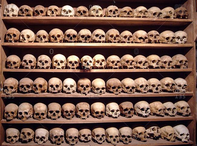 Rows of human skulls on shelves, Varlaam Monastery, Meteora, Thassaly, Greece