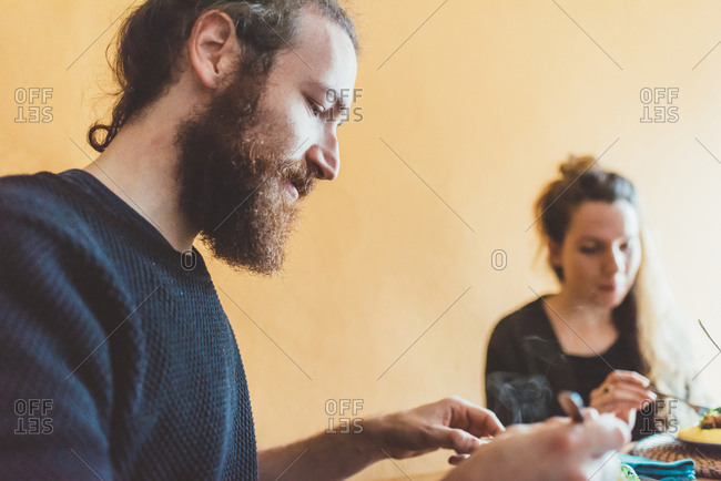Couple eating lunch at kitchen table