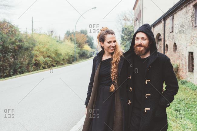 Couple strolling along rural road
