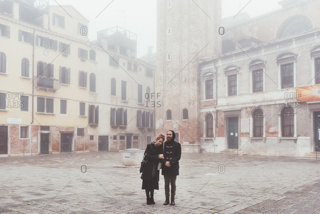 Portrait of couple in misty , Venice, Italy