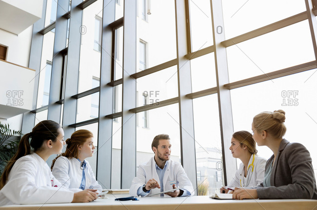 Group of doctors in meeting with consultant