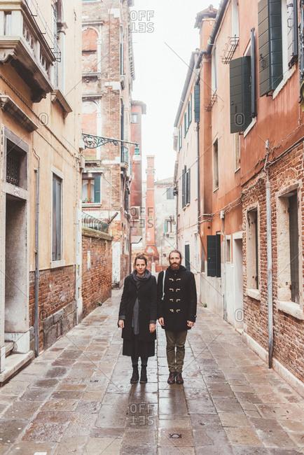 Portrait of couple in street, Venice, Italy