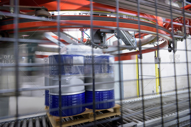 Barrels of oil being wrapped in plastic in oil blending factory