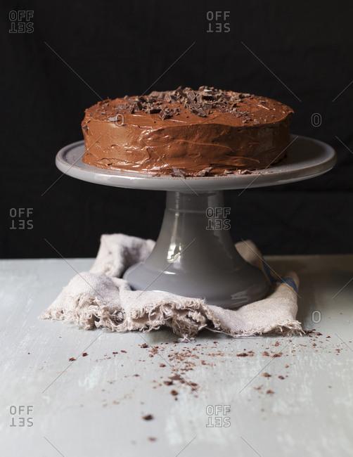 Home-style chocolate cake on cake stand