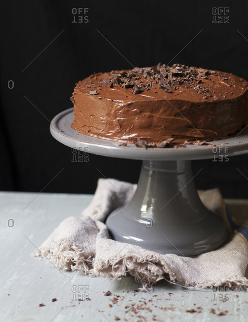 Home-style chocolate cake on a grey cake stand