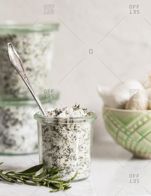 Glass jar full of salt and herbs