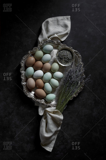 Multicolored eggs on a silver platter
