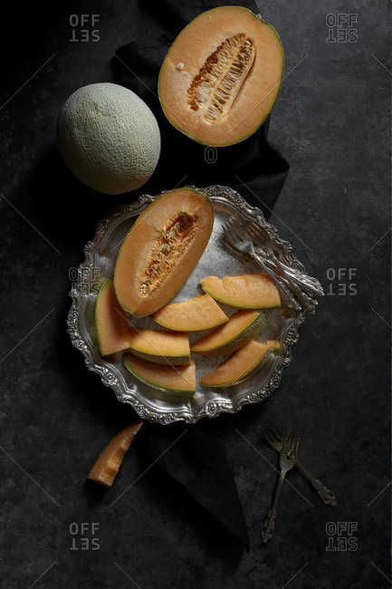 Cantaloupe arranged on a silver platter