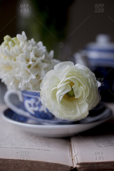 Breakfast tea on a book with flowers