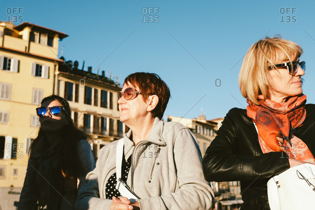 Florence, Italy - May 9, 2017: Three woman in shadows in plaza