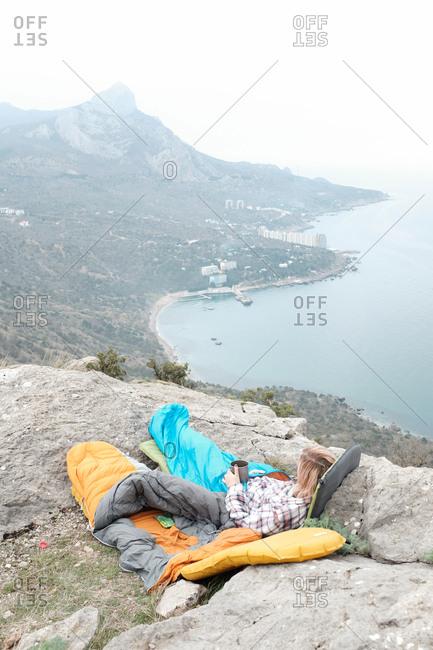 Camp gear on coastal mountaintop