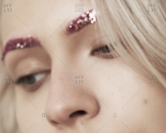 April 22, 2014: Close-up of woman with glitter eyebrow makeup
