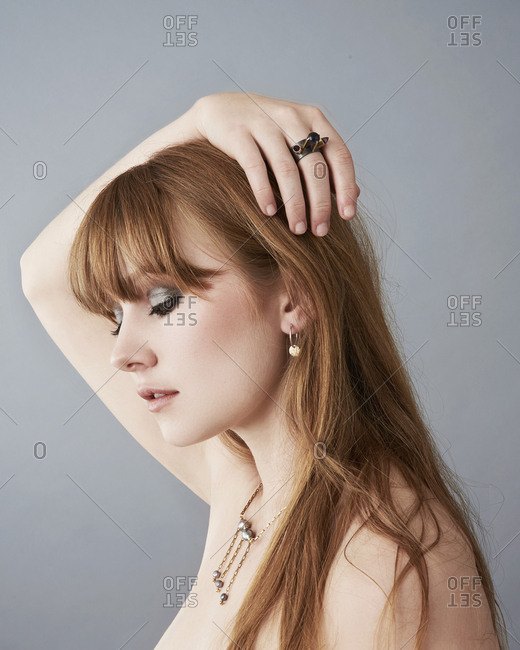 June 15, 2014: Red haired woman modeling jewelry