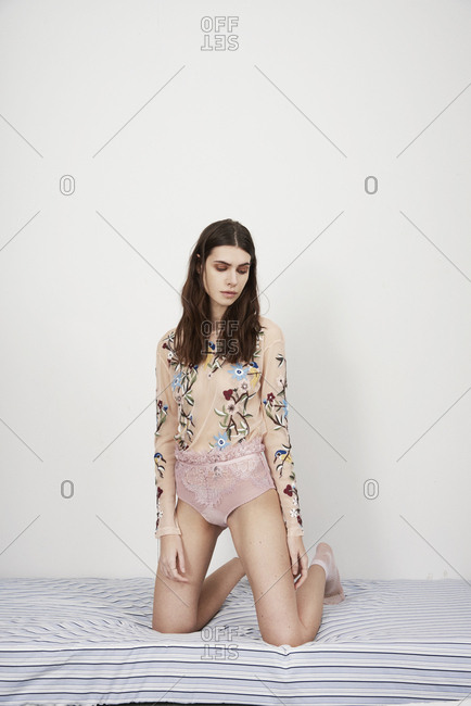 March 16, 2014: Model in lace underpants and flowered blouse