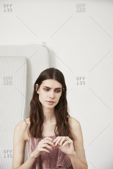 March 16, 2014: Fashion model in pink top standing near mattresses