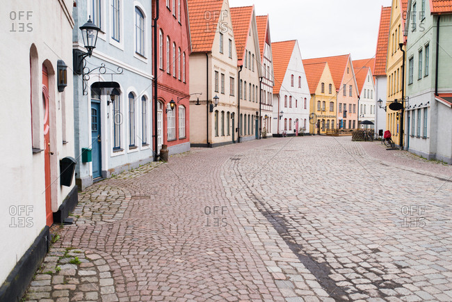 Quaint buildings on a quiet cobblestone city street