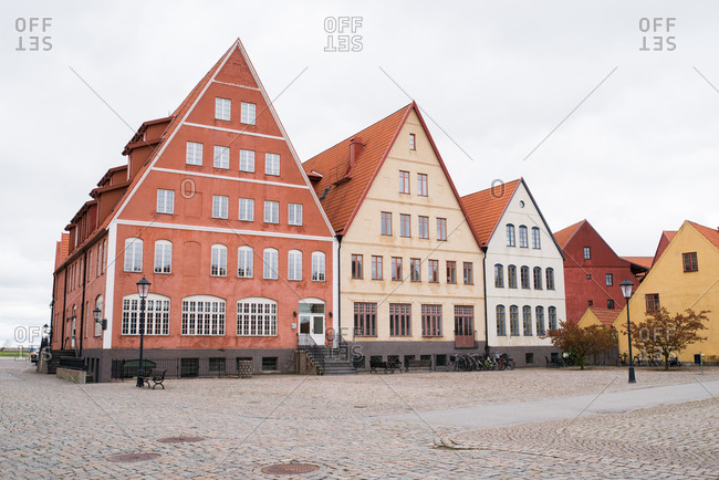 Buildings with sharply pointed rooves on a quiet cobblestone street