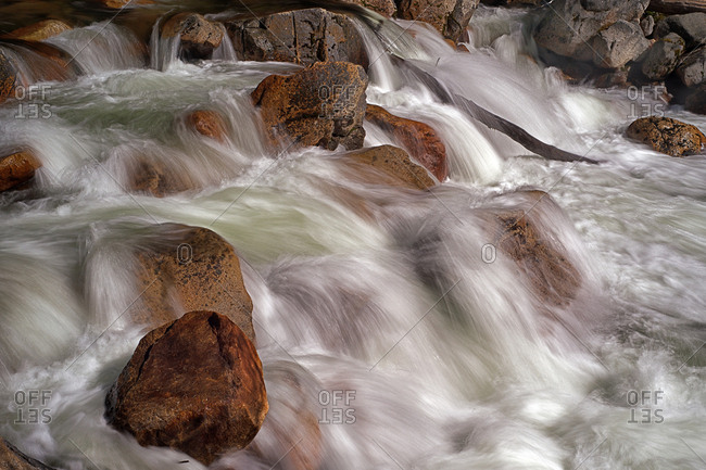 Water rushing over rocks in a river at Yosemite National Park