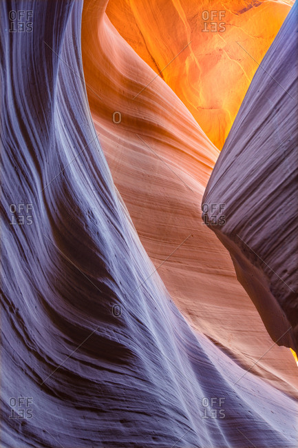 Light shining on curved stone walls in Antelope Canyon, Arizona