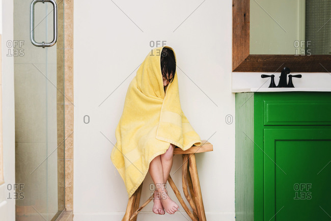Young girl wrapped in a towel after a bath