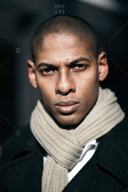 Confident young man wearing warm clothes looking at camera.