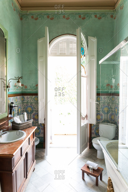 Inside shot of beautiful bathroom in oriental style with big window.