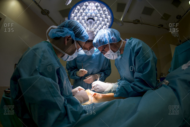 Surgeons doing an Achilles tendon surgery