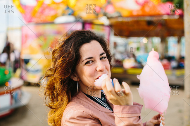 Woman with cotton candy in the park