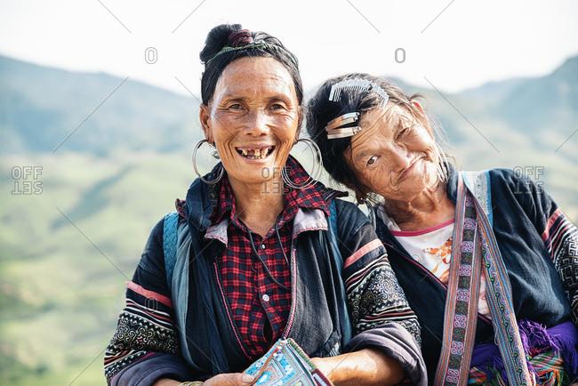 SAPA, VIETNAM - AUGUST 18: Old Women of the Flower H'mong ethnic on August 18, 2016 in Sapa, Vietnam.