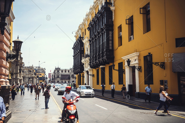 LIMA, PERU - DECEMBER 26, 2016: People walking in the street near the Town Hall of Lima in Peru. Horizontal outdoors shot.