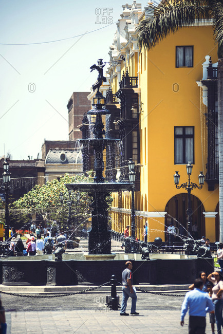 LIMA, PERU - DECEMBER 26, 2016: Vertical outdoors shot of the people walking at the fountain in the Main Square of Lima, Peru.