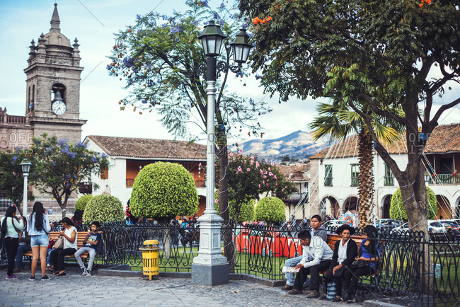 AYACUCHO, PERU - DECEMBER 30, 2016: Horizontal outdoors shot of the people sitting in the park of Ayacucho, Peru.